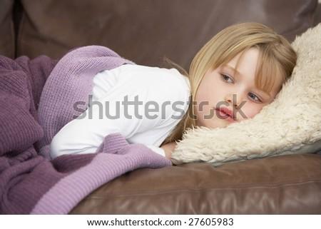 Young Girl Unwell Lying On Sofa - stock photo