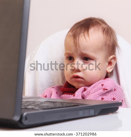 Young Girl Uses Laptop Computer (details) - stock photo