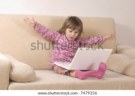 young girl using a laptop. computer generation - stock photo