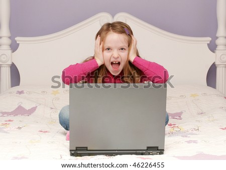 Young girl using laptop - stock photo