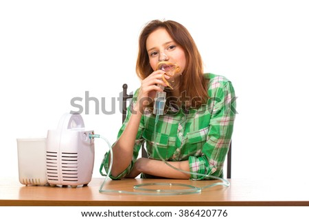 Young girl using nebulizer mask for respiratory inhaler Asthma Treatment isolated on a white background. - stock photo