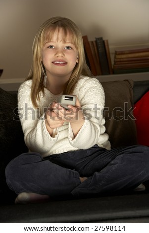 Young Girl Using Remote Control - stock photo
