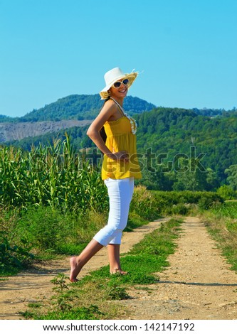 Young girl walking, summer day - stock photo