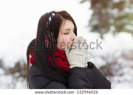 Good cold weather pretty white brunette female wear knit earmuffs and
