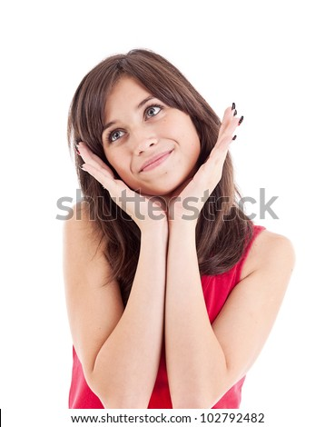 Young girl wear red shirt holding hands on chin, dreaming, isolated over white background - stock photo