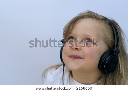 Young girl wearing headset - stock photo