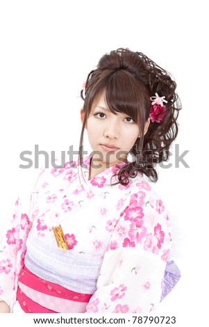 Young girl wearing Japanese kimono, isolated on white background.