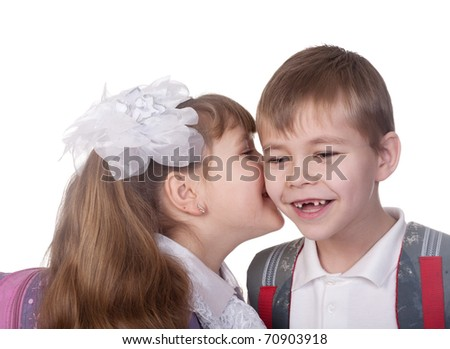 Young girl whispers in boy`s ear. Isolated on white - stock photo