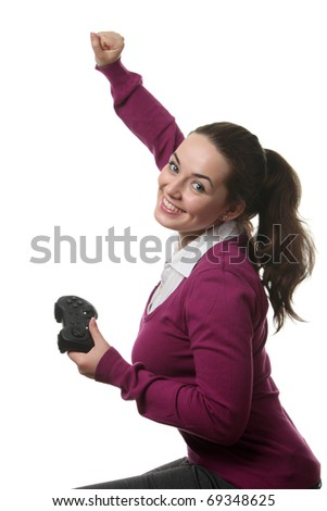 Young girl with a gamepad play video-game - stock photo
