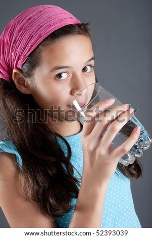 Young girl with a glass of water, concept of healthy lifestyle - stock photo