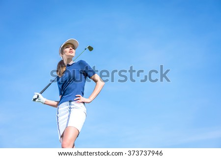 Young girl with a golf club outdoors - stock photo