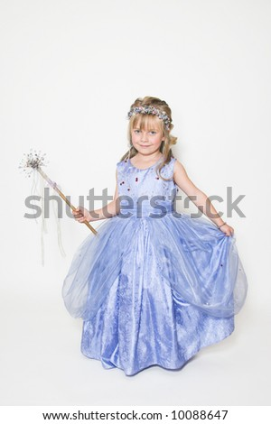 Young girl with a lavender dress and fairy-wand - stock photo