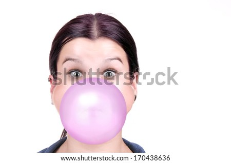 young girl with a pink bubble of chewing gum on white background - stock photo