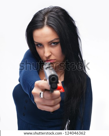 Young girl with a pistol on a white background - stock photo