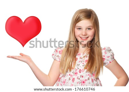 young girl with  a red heart over her hand - stock photo