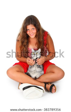 young girl with a scottish cat in her arms - stock photo
