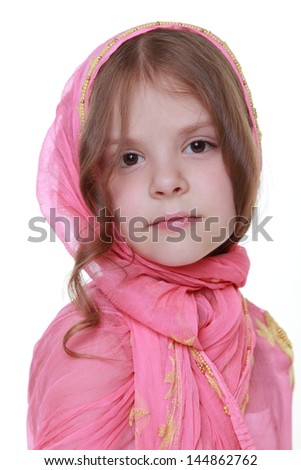 young girl with a sweet smile in the eastern scarf isolated on white on Beauty and Fashion