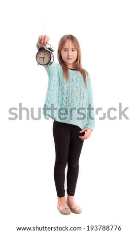 Young girl with an alarm clock - stock photo