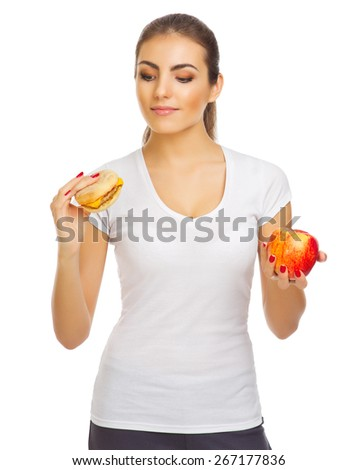 Young girl with apple and hamburger isolated - stock photo
