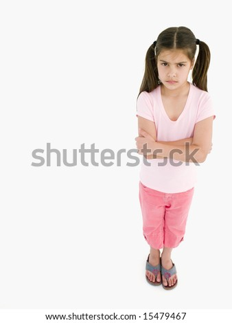 Young girl with arms crossed angry - stock photo