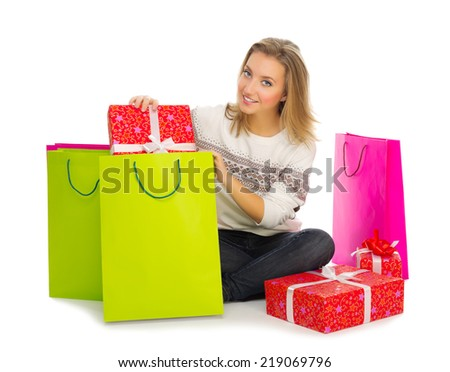 Young girl with bags and gift boxes  isolated - stock photo