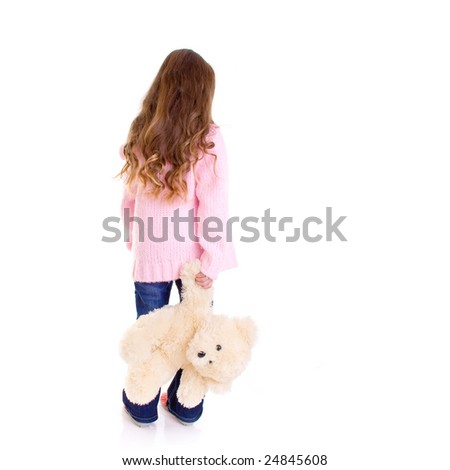 Young girl with bear on white background