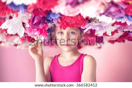 Young girl with big hat made of flowers - stock photo