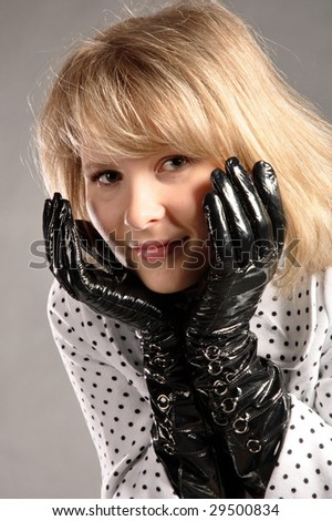 young girl with black gloves