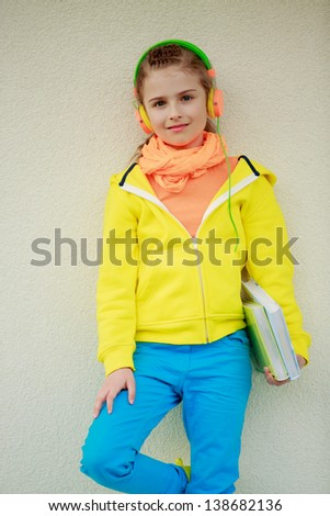 Young girl with books enjoying music . Lifestyle of young people concept. - stock photo