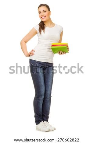 Young girl with books isolated - stock photo