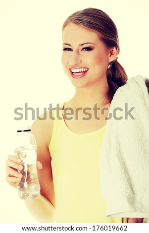 Young girl with bottle of mineral water