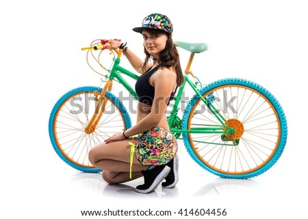 Young girl with colorful bike