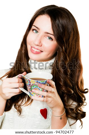 Young girl with cup of hot tea - stock photo