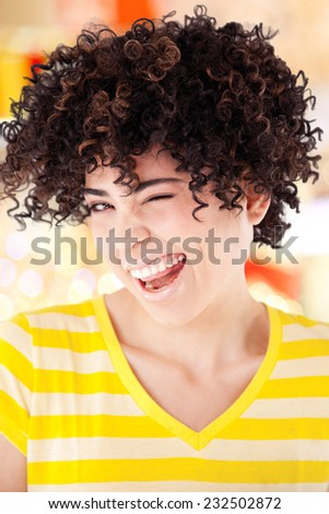 Young girl with curly hair and shirt with yellow stripes isolated with work path. - stock photo
