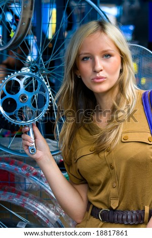 young girl with cycling details - stock photo