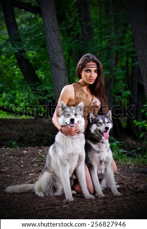 Young girl with dogs at forest - stock photo