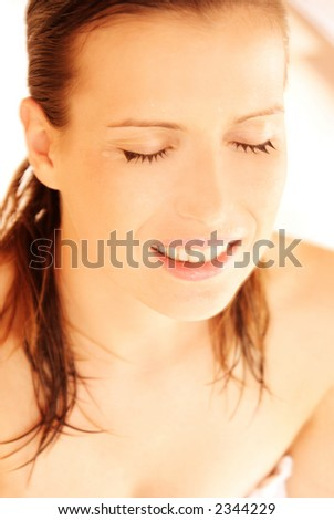 Young girl with drops of water on her face - stock photo
