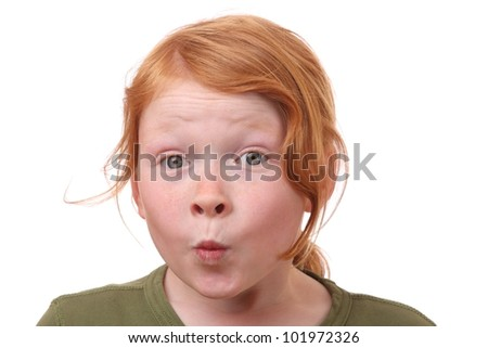Young girl with eyes wide open on white background - stock photo