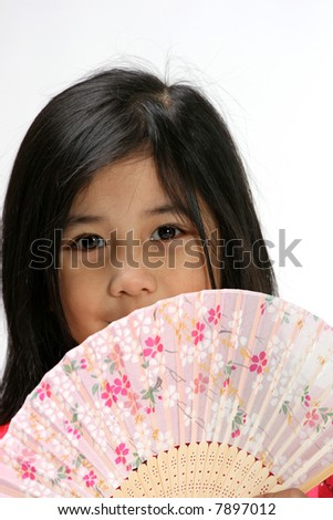 Young girl with fan - stock photo