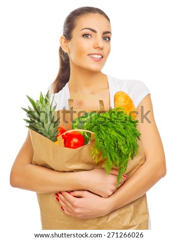 Young girl with full food bag isolated - stock photo