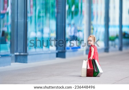 Young girl with full of bags. - stock photo