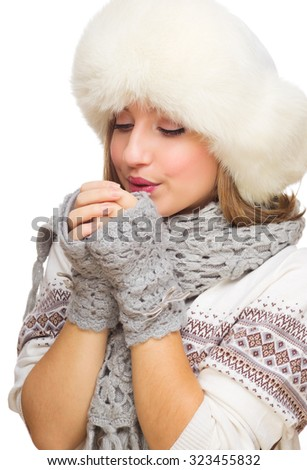 Young girl with fur hat isolated - stock photo