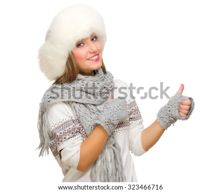 Young girl with fur hat showing ok gesture isolated - stock photo
