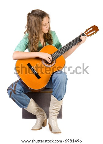 Young girl with guitar. Isolate on white. - stock photo