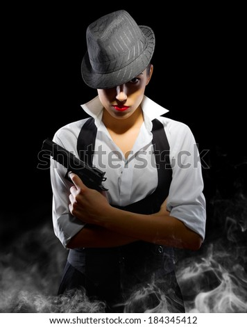 Young girl with gun and hat - stock photo