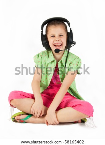 Young girl with headphones and microphone - stock photo