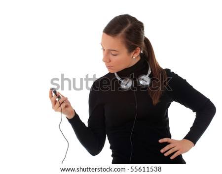 young girl with headphones and mp3 player - stock photo