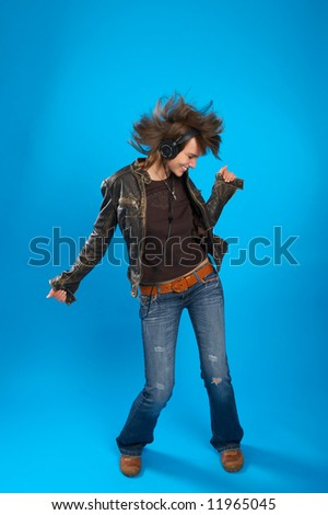 young girl with headphones dancing - stock photo