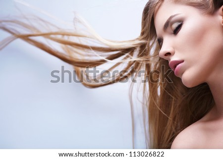 Young girl with healthy hair flying - stock photo