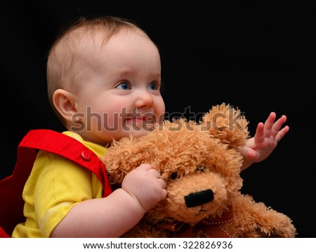Young girl with her favourite teddy - stock photo